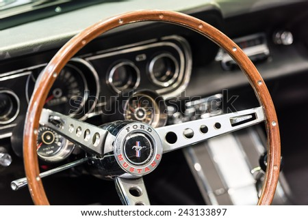 BUCHAREST, ROMANIA - OCTOBER 31, 2014: 1966 Ford Mustang Interior. The Ford Mustang is an automobile manufactured by the Ford Motor Company and was introduced on April 17, 1964. - stock photo