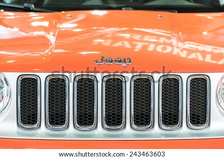 BUCHAREST, ROMANIA - OCTOBER 30, 2014: Jeep Grand Cherokee Sign Close Up. From 1992 is a mid-size SUV produced by the Jeep division of American manufacturer Chrysler. - stock photo