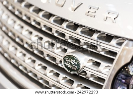 BUCHAREST, ROMANIA - OCTOBER 31, 2014: Land Rover Sign Close Up. Founded in 1948 is a brand of the British car manufacturer Jaguar Land Rover, which specializes in four-wheel-drive vehicles. - stock photo