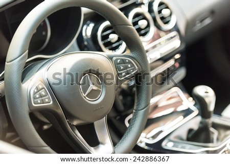 BUCHAREST, ROMANIA - OCTOBER 31, 2014: Mercedes Benz C200 Interior View. Founded in 1926 is a German luxury automobile manufacturer, a multinational division of the German manufacturer Daimler AG. - stock photo