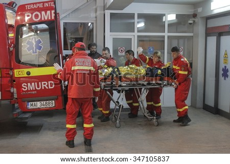 Bucharest, Romania, October 31, 2015: Romanian paramedics transfer a wounded person, who survived from a fire at Colectiv Club from the Emergency Hospital Floreasca to a burn center.  - stock photo
