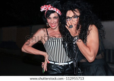 BUCHAREST, ROMANIA - SEPT 15: Merante Tamar van Amersfoort (L), official replica of singer Amy Winehouse, perform a concert in club in Bucharest, Saturday, August 15, 2012 - stock photo