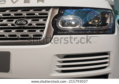 BUCHAREST, ROMANIA - September 08 , 2014: All-New Range Rover Vogue SE car on display in showroom. Jaguar Land Rover employs 25,000 people and sells vehicles in 170 countries around the world. - stock photo