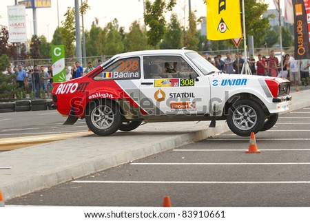 BUCHAREST,ROMANIA - SEPTEMBER 02: Badina Eugen drives a Ford Escort Mk2 car during Rally of Romania 2011 championship on September 02, 2011 in Bucharest, Romania. - stock photo