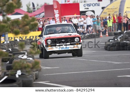 BUCHAREST,ROMANIA - SEPTEMBER 02: Badina Eugen drives a Ford Escort Mk2 car during Rally of Romania 2011 championship on September 02, 2011 in BUCHAREST,ROMANIA. - stock photo