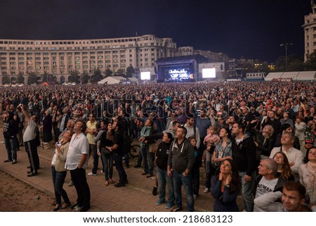 BUCHAREST, ROMANIA - September 21: Crowd is watching fireworks near the People's House in Bucharest, on September 21, 2014. Bucharest celebrates the 555 anniversary.  - stock photo