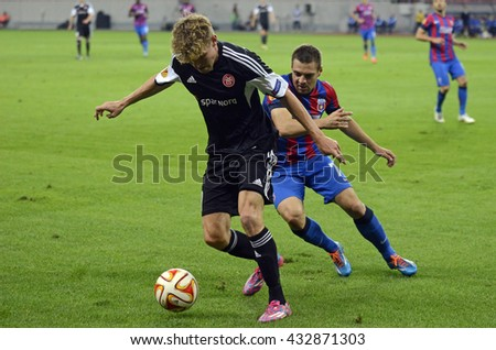 BUCHAREST, ROMANIA - SEPTEMBER 18, 2014: Soren Frederiksen and Adrian Popa pictured during the UEFA Europa League game between Steaua Bucuresti and Aalborg on National Arena. - stock photo