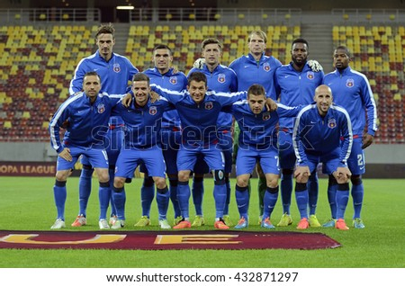 BUCHAREST, ROMANIA - SEPTEMBER 18, 2014: Steaua line up pictured prior to the UEFA Europa League game between Steaua Bucuresti and Aalborg on National Arena. - stock photo