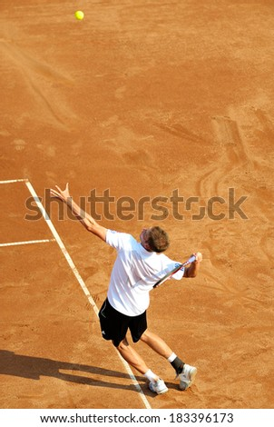 BUCHAREST, ROMANIA - SEPTEMBER 17: Unidentified tennis player in action during BRD Nastase Tiriac Trophy on September17, 2011 in Bucharest, Romania - stock photo