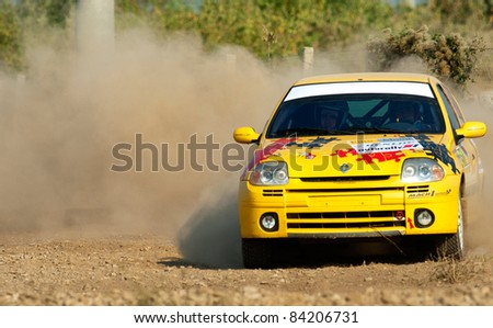 BUCHAREST, ROMANIA - SEPTEMBER 02: Unknown car driver piloting his car at Barsa Rally 2011 stage Baneasa Rally Show on September 02, 2011, Bucharest, Romania - stock photo