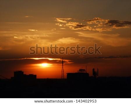 BUCHAREST, ROMANIA- sunset - stock photo