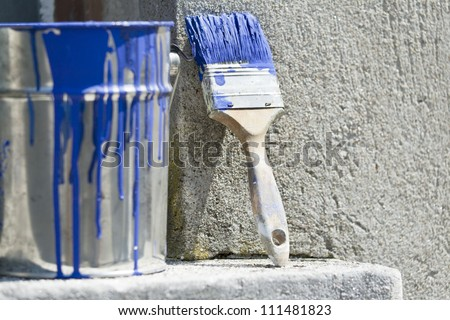 bucket and paint to paint the walls of the house - stock photo