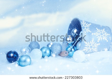 Bucket of Christmas balls on winter background.  - stock photo
