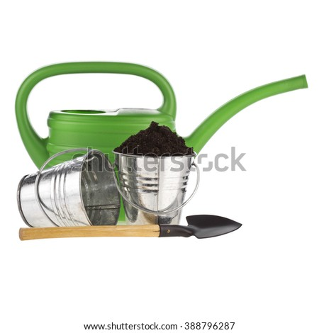 Bucket, shovel,watering can,soil isolated on white background - stock photo
