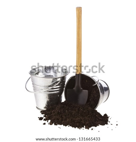Bucket, spade, soil on white background - stock photo