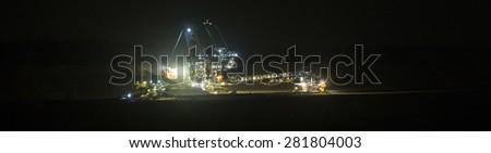 bucket-wheel excavator at night in open-cast coal mining hambach germany - stock photo