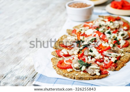 buckwheat Chia seed pizza crust with mushrooms, tomato, Basil and cheese. toning. selective focus - stock photo