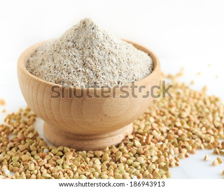 buckwheat flour and grains - stock photo