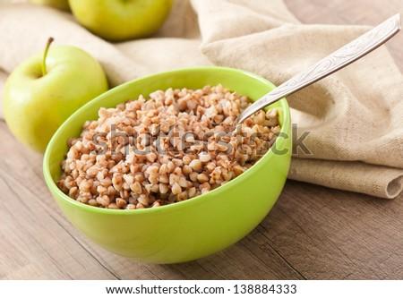 buckwheat porridge and green apple - diet concept - stock photo