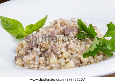 Buckwheat porridge with duck and apples - stock photo