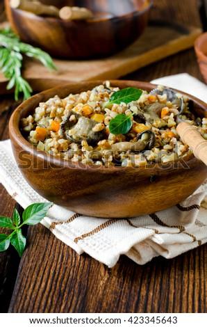 Buckwheat stewed with mushrooms - stock photo