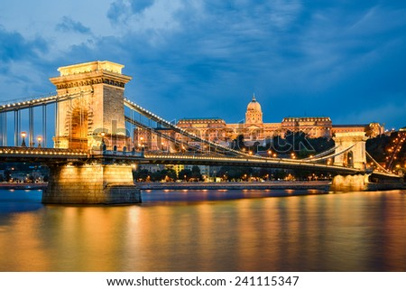 Buda Castle and Chain Bridge at night in Budapest, Hungary - stock photo