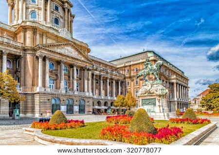 Buda Castle and equestrian  statue of Prince Eugene of Savoy in Budapest, Hungary - stock photo