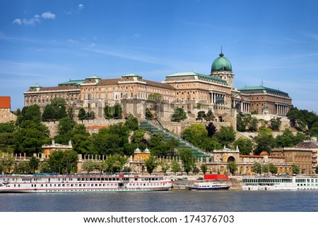 Buda Castle (Royal Palace) and passenger boats on the Danube River in Budapest, Hungary. - stock photo
