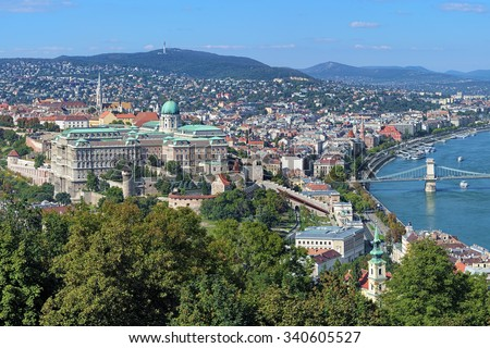 Buda Castle with Royal Palace and Matthias Church and fragment of the Szechenyi Chain Bridge over Danube in Budapest, Hungary. View from the Gellert Hill. - stock photo
