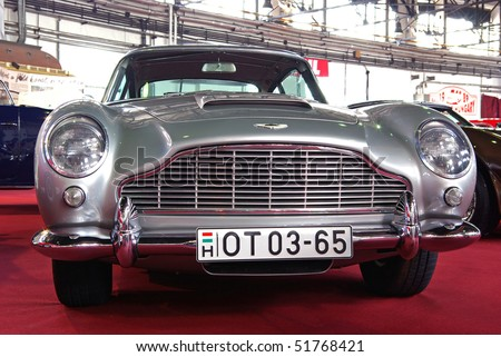 BUDAPEST-APRIL 16: Front of James Bond's car 1965's Aston Martin DB5 renovated by Aston Workshop on 4th Oldtimer Expo on April 16, 2010 in Budapest, Hungary - stock photo