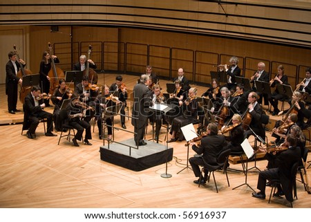 BUDAPEST - APRIL 27: Members of the Anima Eterna Philharmonic Orchestra perform on stage at MUPA, Conductor: Jos van Immerseel on April 27, 2010 in Budapest, Hungary. - stock photo