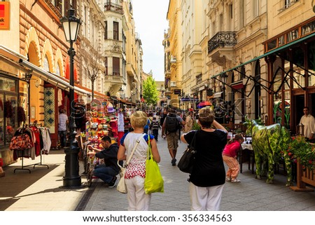 BUDAPEST APRL 29 2014: The newly renovated inner city in Budapest is a big attraction for tourists all over the world. Budapest's beauty shown through many centuries of architecture, Hungary.  - stock photo