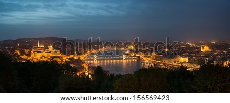 Budapest by night: Royal Palace of Buda and river Danube - stock photo