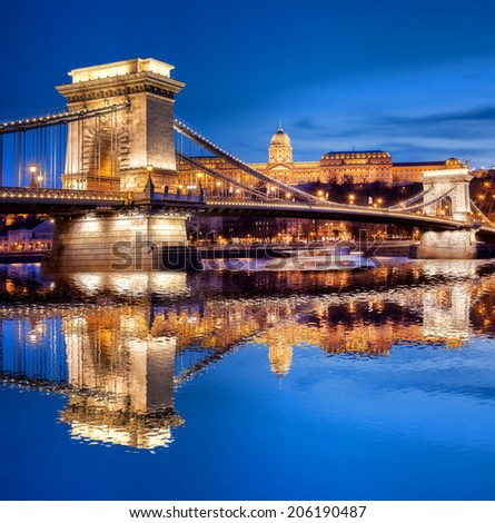 Budapest castle and chain bridge in the evening, Hungary - stock photo