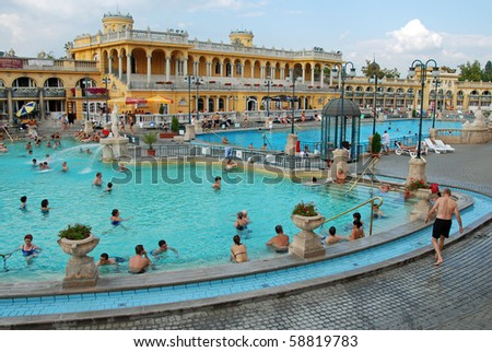 BUDAPEST - CIRCA SEPTEMBER 2009: People bathe in the Szechenyi spa circa September 2009 in Budapest. Szechenyi Medicinal Bath is the largest medicinal bath in Europe. - stock photo