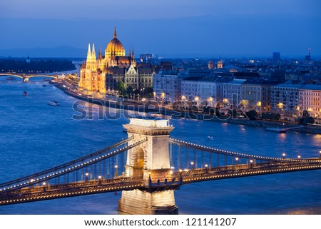 Budapest cityscape at night with Chain Bridge over Danube river and Parliament Building in the background. - stock photo