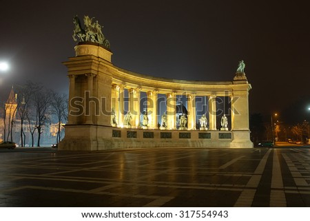BUDAPEST - DECEMBER 12, 2012: Side view on Heroes' Square monument illuminated in evening, one of the major squares in Budapest, Hungary - stock photo