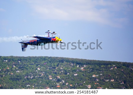 BUDAPEST, HUNGARY - APRIL 30:  Aerobatics planes fly-by   at Budaors airport These planes are designed for aerobatic and tanning  flights on April 30, 2014 near Budapest, Hungary.  - stock photo