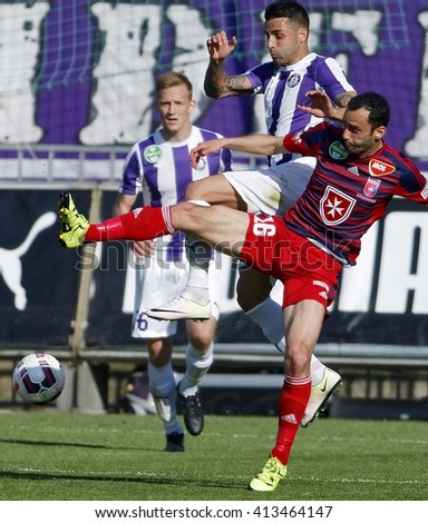 BUDAPEST, HUNGARY - APRIL 30, 2016: Cseke watches the battle for the ball between Lencse of UTE and Oliveira of Videoton (r) during Ujpest - Videoton OTP Bank League football game at Szusza Stadium. - stock photo