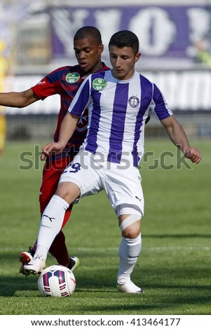 BUDAPEST, HUNGARY - APRIL 30, 2016: Enis Bardhi of Ujpest (r) duels for the ball with Loic Nego of Videoton during Ujpest - Videoton OTP Bank League football match at Szusza Stadium. - stock photo
