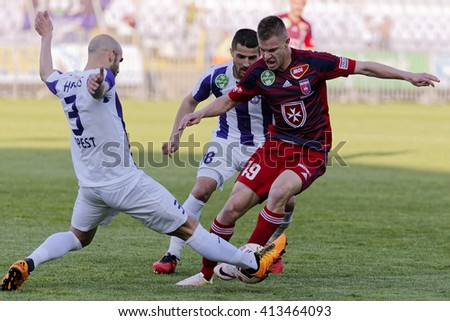 BUDAPEST, HUNGARY - APRIL 30, 2016: Heris (l) and Sankovic of UTE fight for the ball with Krisztian Geresi (r) of Videoton during Ujpest - Videoton OTP Bank League football game at Szusza Stadium - stock photo