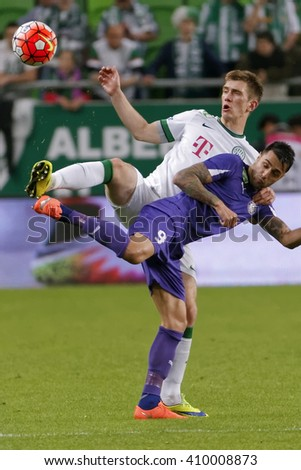 BUDAPEST, HUNGARY - APRIL 23, 2016: Michal Nalepa of Ferencvaros (l) duels for the ball with Laszlo Lencse of Ujpest during Ferencvaros - Ujpest OTP Bank League football match at Groupama Arena. - stock photo
