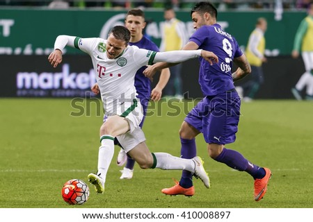 BUDAPEST, HUNGARY - APRIL 23, 2016: Vladan Cukic of Ferencvaros (l) is fouled by Laszlo Lencse of Ujpest during Ferencvaros - Ujpest OTP Bank League football match at Groupama Arena. - stock photo