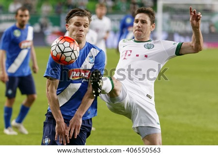 BUDAPEST, HUNGARY - APRIL 16, 2016: Zoltan Gera of Ferencvaros (r) fights for the ball with Daniel Gera of MTK during Ferencvaros - MTK Budapest OTP Bank League football match at Groupama Arena.  - stock photo