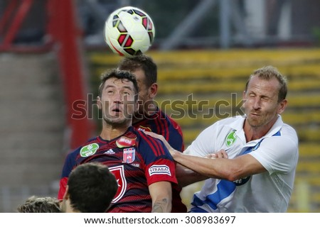 BUDAPEST, HUNGARY - AUGUST 23, 2015: Air battle between Sandor Torghelle of MTK (r) and Robert Feczesin of Videoton during MTK vs. Videoton OTP Bank League football match in Illovszky Stadium.  - stock photo