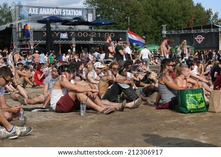 BUDAPEST, HUNGARY - AUGUST 16, 2014: Fans of Sziget music festival in front of the main stage, waiting and relaxing. Sziget is one of biggest festivals in Europe - stock photo