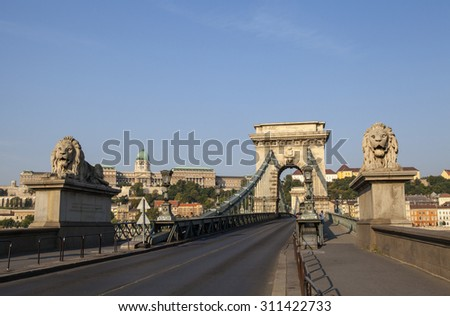 BUDAPEST, HUNGARY - AUGUST 15TH 2015: A view of the historic Chain Bridge and Buda Castle in Budapest, on 15th August 2015. - stock photo