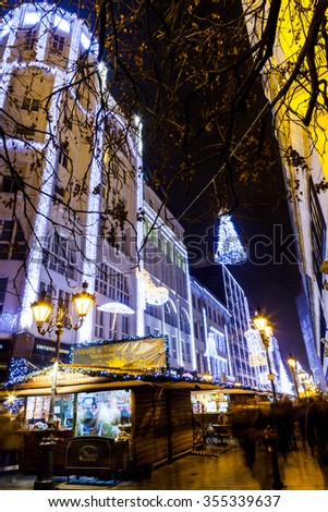 BUDAPEST, HUNGARY - DEC 19 2015: Tourists enjoy the Christmas spirit and the light show in down town Budapest. This traditional Christmas fair attracts over million visitors each year. - stock photo