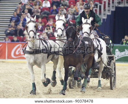 BUDAPEST, HUNGARY - DECEMBER 3: An unidentified competitor driving with his cart at the OTP Equitation World Cup, December 3, 2011 in Budapest, Hungary - stock photo