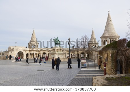BUDAPEST, HUNGARY - FEBRUARY 02: Tourists walking around Fisherman's Bastion, with bronze statue of Saint Stephen in the Old Town district. February 02, 2016 in Budapest. - stock photo